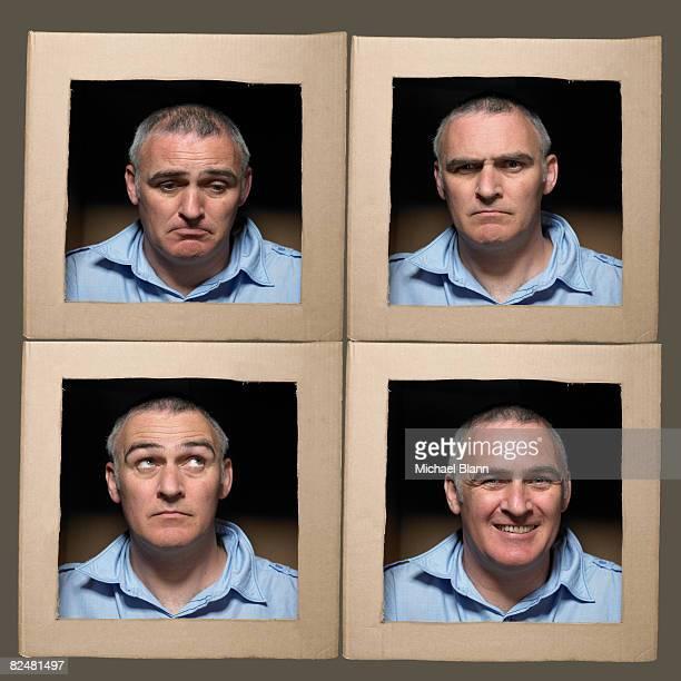 Mann mit Kopf in Schachteln ziehen Gesichter