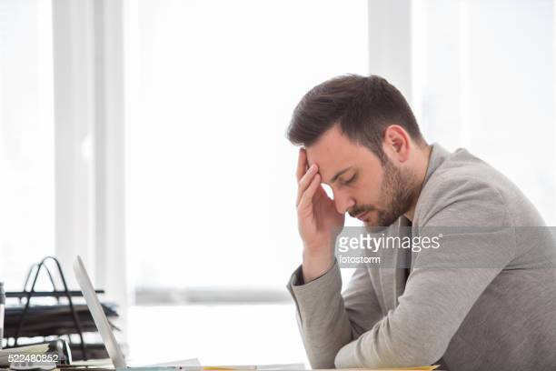 Man with headache at office