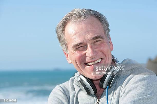 Man with headphones around his neck