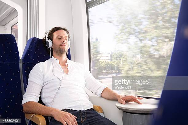 Man with headphones in a train