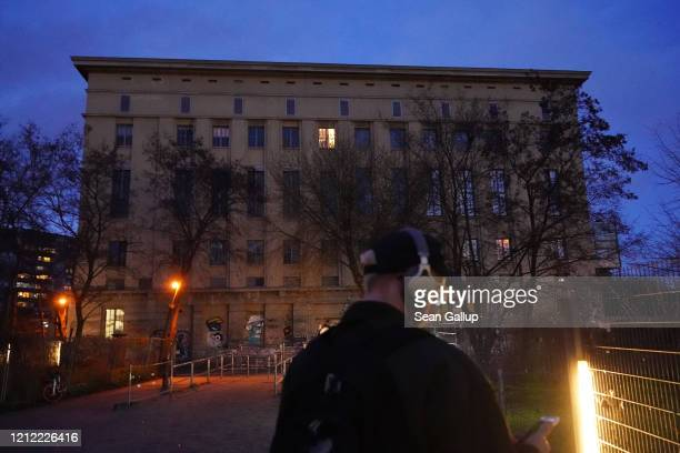 A man with headphones stands in front of the Berghain club which is temporarily closed on March 13 2020 in Berlin Germany Berlin authorities are...