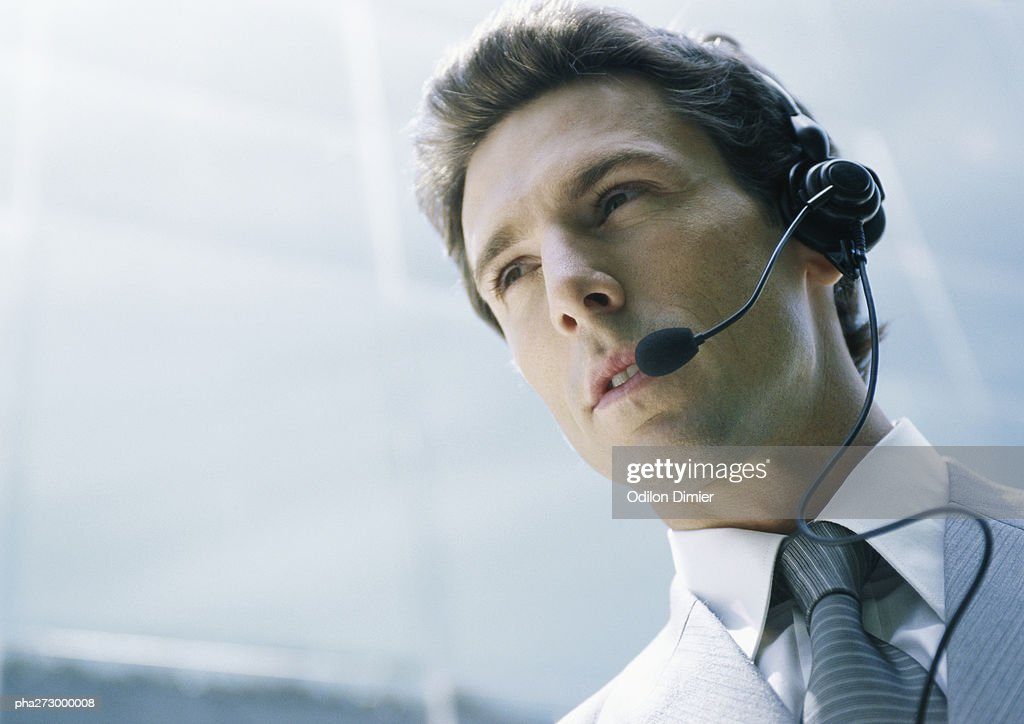 Man with headset, low angle shot : Stockfoto