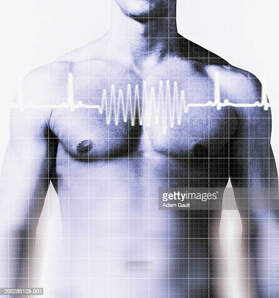 Man with heart rate graph over chest, mid section (Digital Composite)
