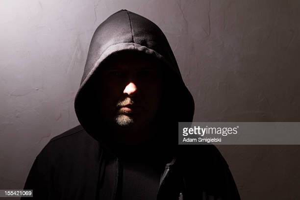 man with hidden face - criminal stock pictures, royalty-free photos & images