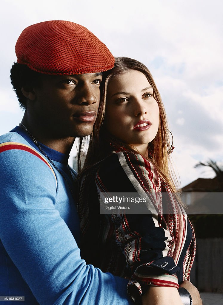 Man With His Arms Around a Young Woman : Stock Photo