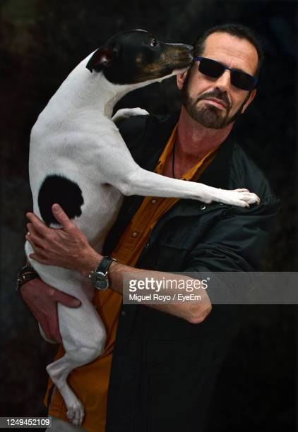 man with his dog in his arms - fashion show stock pictures, royalty-free photos & images