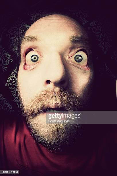 man with his eye lids pulled back - scott macbride stock pictures, royalty-free photos & images