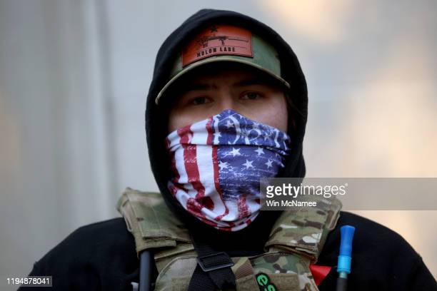 A man with his face covered joins thousands of gun rights advocates at a rally organized by The Virginia Citizens Defense League on Capitol Square...