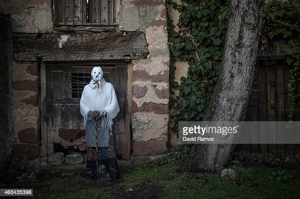 A man with his face covered with a mask know as 'Mascarita' poses for a picture as he joins a carnival festival on February 14 2015 in Luzon Spain...