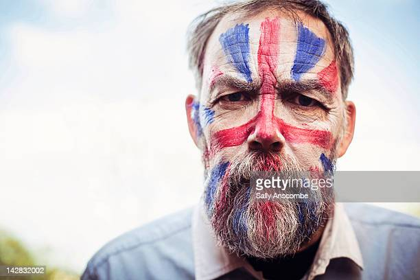 man with his face painted - body paint stock pictures, royalty-free photos & images