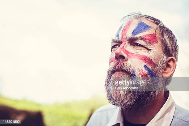 man with his face painted - patriotism stock pictures, royalty-free photos & images