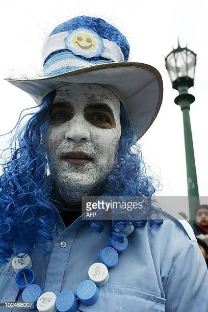 A man with his face painted with the Argentine colours is seen among fans watching the FIFA World Cup South Africa 2010 football match against Mexico...