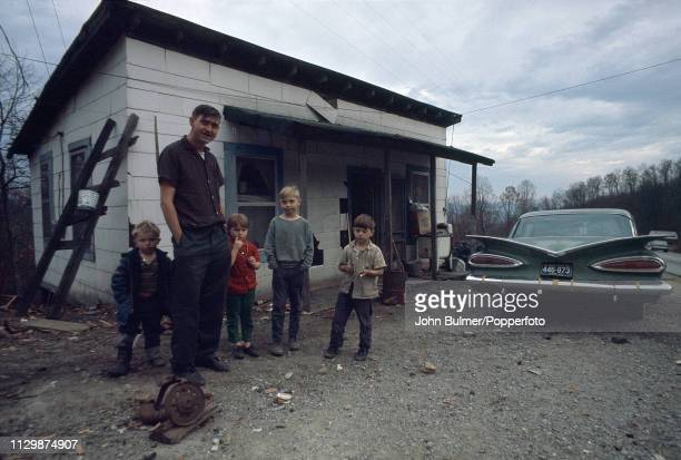 A man with his four children and a Chevrolet Pike County Kentucky US 1967