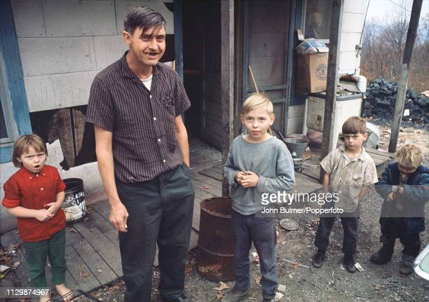 A man with his four children Pike County Kentucky US 1967