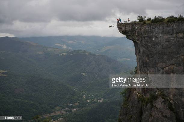 A man with his friends doing bungee jump from a cliff Occitanie Florac France on June 28 2017 in Florac France