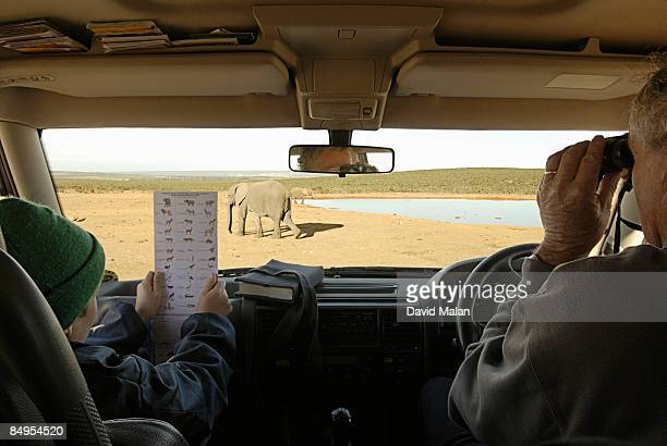 Man with his grandson on game drive. Eastern Cape Province, South Africa