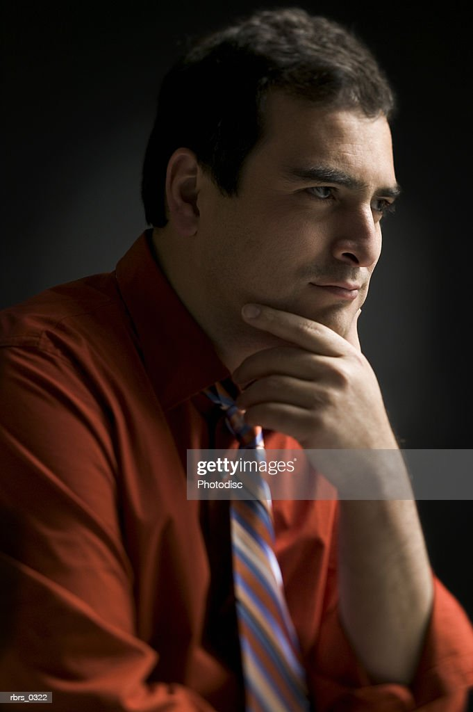 Man with his hand on his chin : Foto de stock