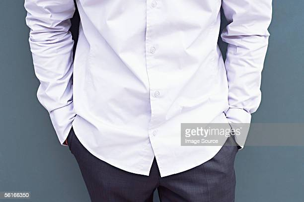 man with his hands in his pockets - torso stock pictures, royalty-free photos & images