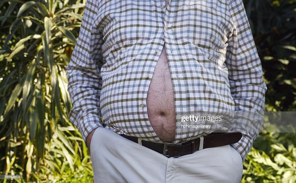 Man with His Large Belly Bursting Through His Shirt : Stock Photo
