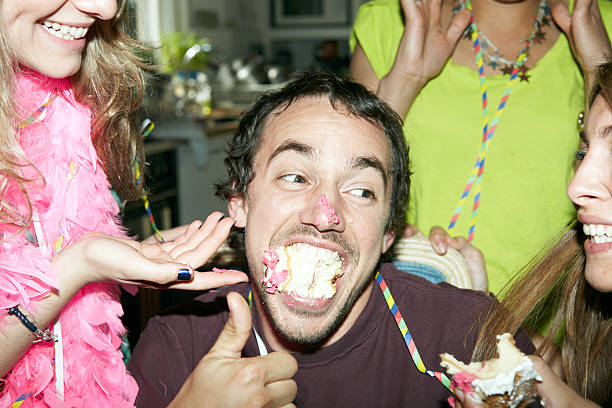 man with his mouth full of cake - best friend birthday cake stock pictures, royalty-free photos & images