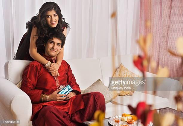 man with his sister at raksha bandhan - raksha bandhan stock photos and pictures