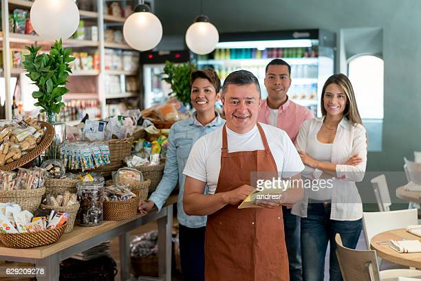 Man with his team working at the supermarket