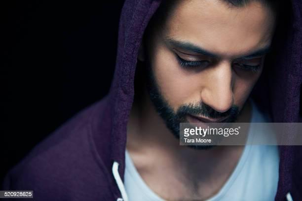 man with hoodie looking down