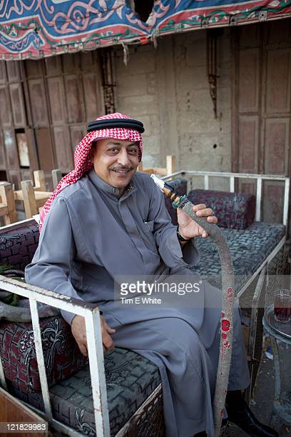 Man with hookah, Al-Balad, Old town, Jeddah, Saudi Arabia, Middle East