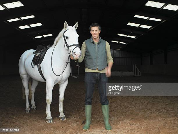 man with horse - zoo keeper stock pictures, royalty-free photos & images