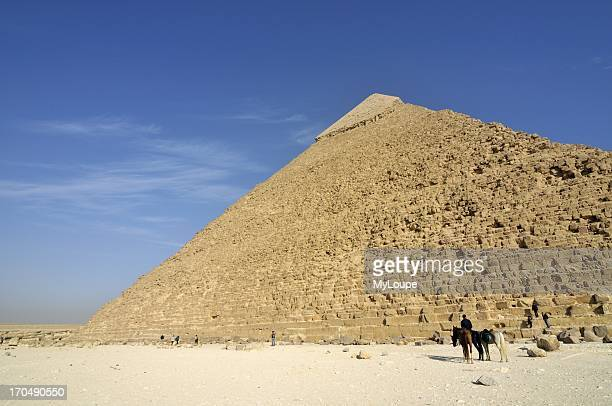 Man with Horses in front of Pyramid of Khafre in Giza Necropolis near Cairo Egypt