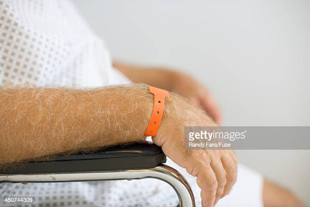 Man with Hospital Wristband Sitting