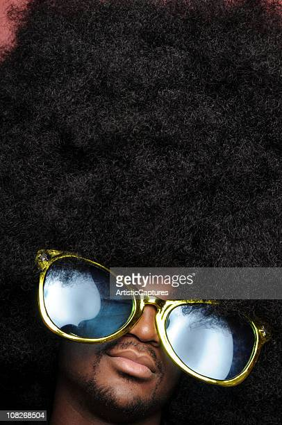 Man With Huge Afro Wearing Large Gold Sunglasses