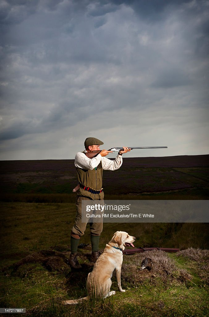 Man with hunting rifle and dog : Stock Photo