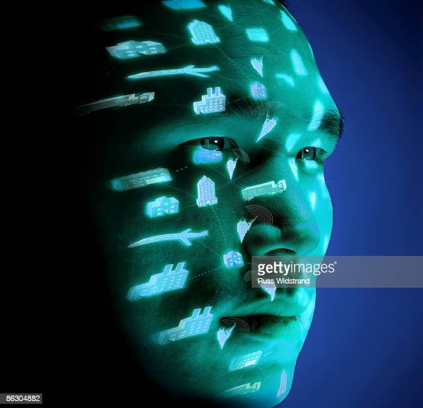 Man with icons projected on his face