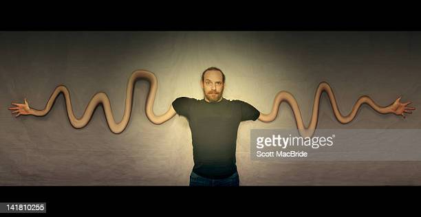 man with incredibly long arms - scott macbride stock pictures, royalty-free photos & images