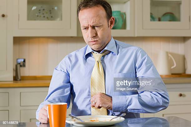 man with indigestion - unhealthy living stock pictures, royalty-free photos & images