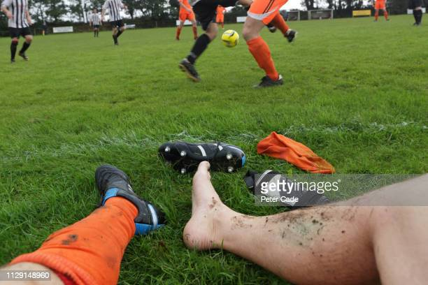 man with injured ankle at football game - match sport stock pictures, royalty-free photos & images