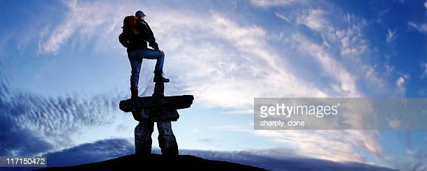 man with inukshuk