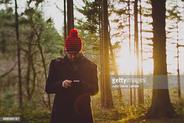 man with iphone in the woods - only mid adult men stock pictures, royalty-free photos & images