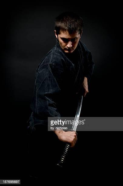 Man with katana, black background