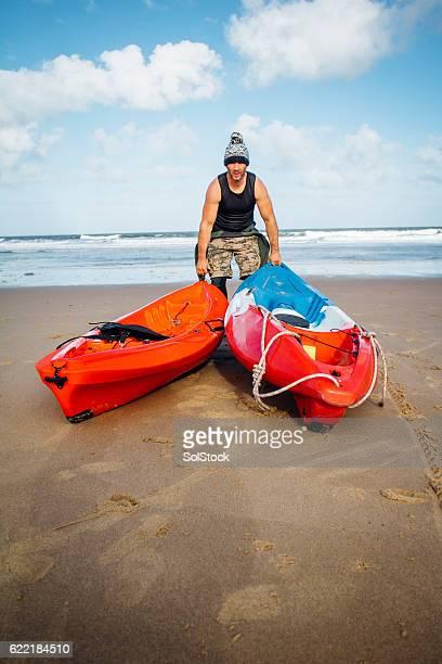 Man with Kayaks on the Beach