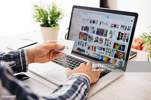 man with laptop and credit card shopping online, partial view - e commerce - fotografias e filmes do acervo