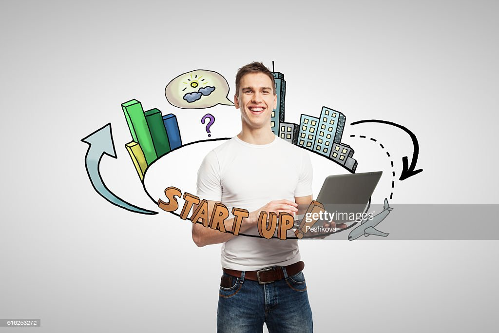 Man with laptop and startup sketch : Stock-Foto