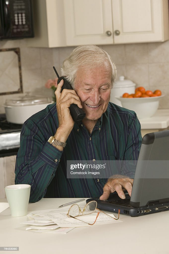 Man with laptop computer and telephone : Stockfoto