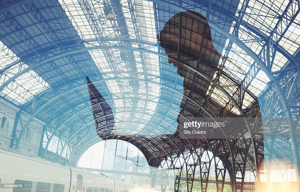 Man with laptop. Double exposure with train station. : Foto stock