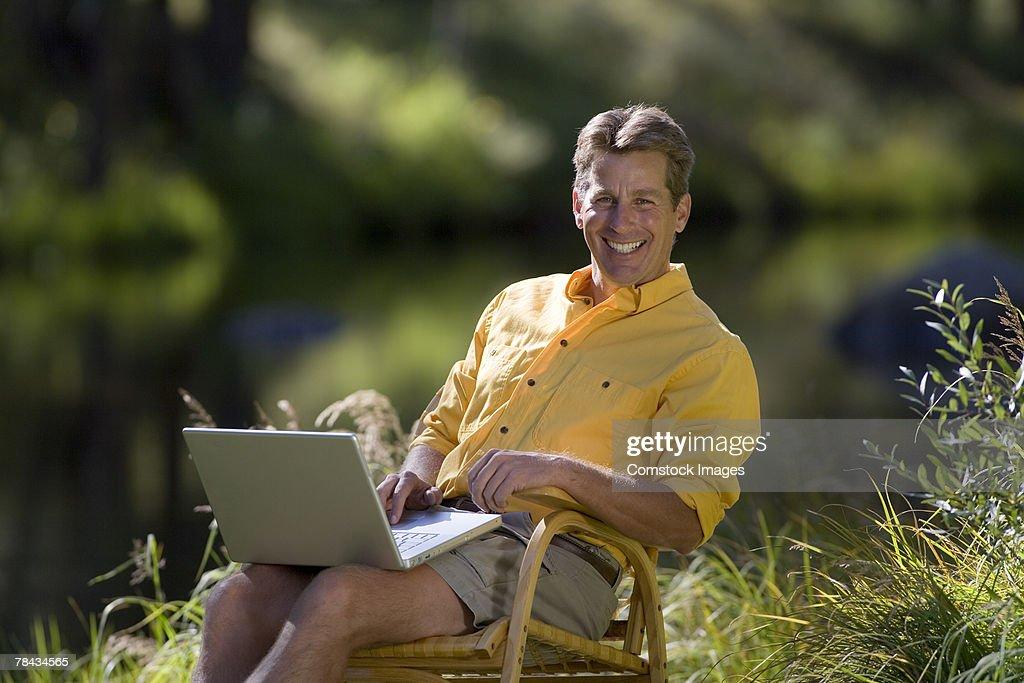 Man with laptop : Stockfoto