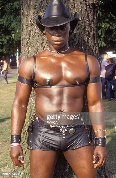A man with large nipples wearing a black cowboy hat and black leather shorts Gay Pride 1997