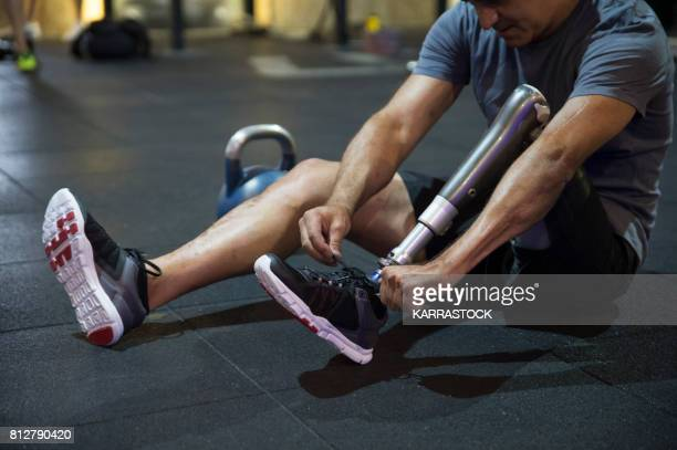 Man with leg amputated in the gym