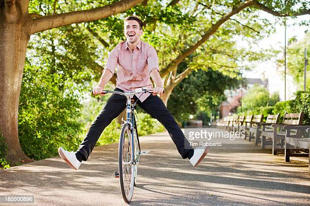 Man with legs in air on bike