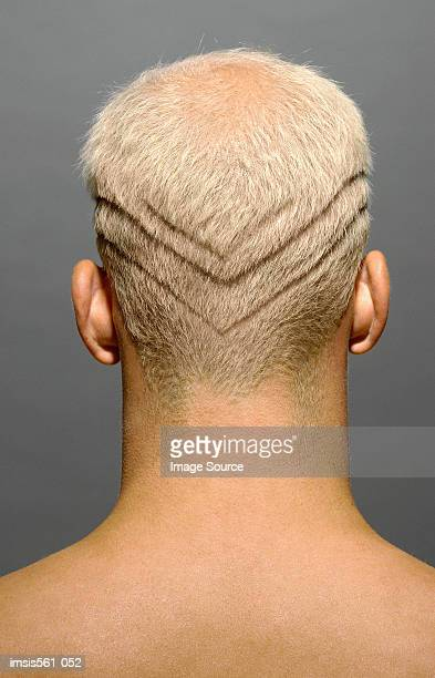 man with lines shaved in hair - coiffure homme photos et images de collection